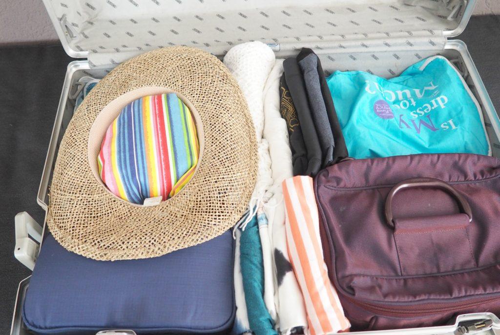 Hut im Koffer packen
